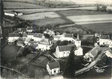 """/ CPSM FRANCE 58 """"Poil, vue aérienne sur la poste et l'église"""""""