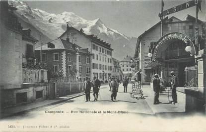 """CPA FRANCE 74 """"Chamonix, rue nationale et le Mont Blanc"""""""