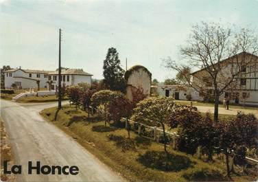 """CPSM FRANCE 64 """"La Honce, le bourg, mairie, école"""""""