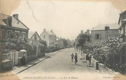 """CPA FRANCE 14 """"Arromanches Les Bains, la rue de Bayeux"""""""