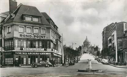 """CPSM FRANCE 14 """"Lisieux, rond Point et avenue Sainte Thérèse"""""""