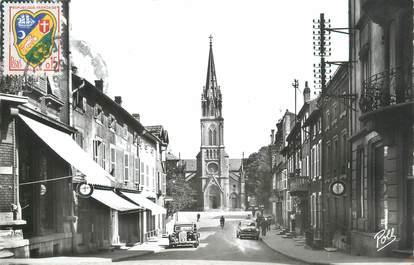 """CPSM FRANCE 57 """"Moyeuvre Grande, la rue Gramont et l'église paroissiale"""""""