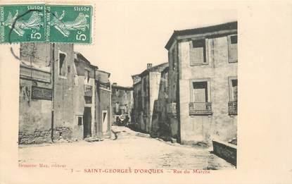 """CPA FRANCE 34 """"Saint Georges d'Orques, rue du Marché"""""""