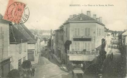 """CPA FRANCE 38 """"Morestel, La Place et la Route de Passin"""""""