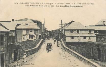 """CPA GUADELOUPE """"Basse Terre, Pont aux Herbes et rue du Cours"""""""