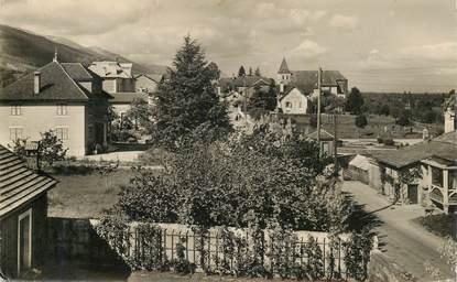 """CPSM FRANCE 01 """"Thoiry, le centre du village et l'Eglise"""""""