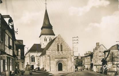 "/ CPSM FRANCE 27 ""Serquigny, l'église et rue Max Carpentier"""
