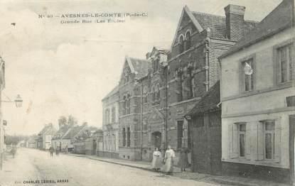 """/ CPA FRANCE 62 """"Avesnes Le Comte, Grande rue, les écoles"""""""