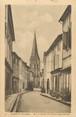 """33 Gironde / CPA FRANCE 33 """"Langon, rue et clocher de l'église Saint Gervais"""""""