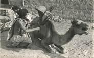 """Afrique CPSM MAURITANIE """"Maure sellant son chameau"""""""