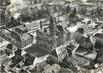 """/ CPSM FRANCE 68 """"Guebwiller, vue aérienne sur le centre de la ville et l'église"""""""