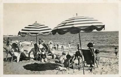 """CPSM """"Cannes, plage du Midi, Bains de Soleil"""""""